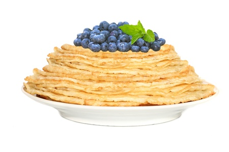 Stack of pancakes with blueberries   isolated on white photo