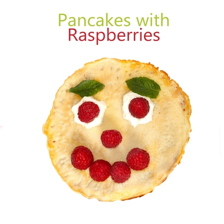 breakfast smiley face: ripe raspberries with mint for kids  isolated on white