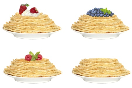 Stack of pancakes with fruit isolated on white photo