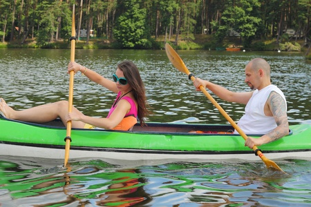 lipno: Young couple kayaking summertime in the sunshine vacation Young couple kayaking summertime in the sunshine vacation  Stock Photo