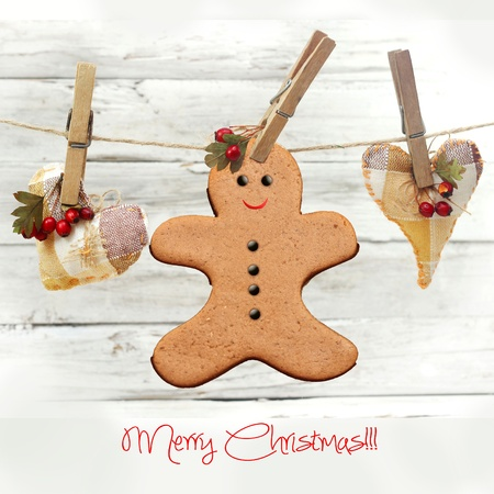 hanging gingerbread man over wooden background  Stock Photo - 22070042