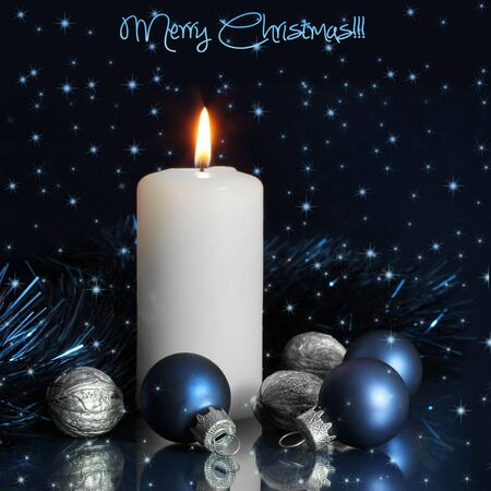 Blue Christmas balls with white candle over dark background photo