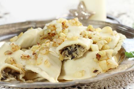 pierogi: homemade pierogi  ravioli  with mushroom and sauerkraut  Traditional polish christmas eve Stock Photo