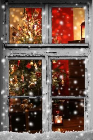 Christmas lights seen through a wooden cabin window