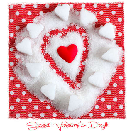 Heart in sugar on red . Valentines symbol  photo