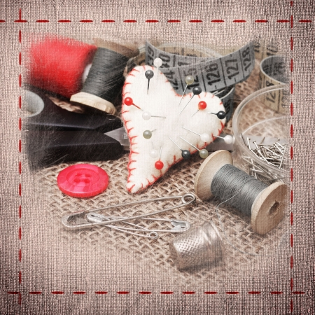 An old style image of cotton reels and other sewing items photo