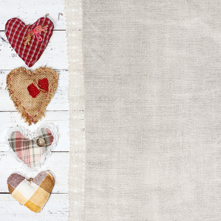 cloth handmade hearts on wooden background  Valentines day photo
