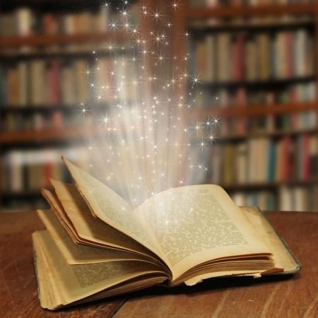 magic book: Opened magic book with magic light