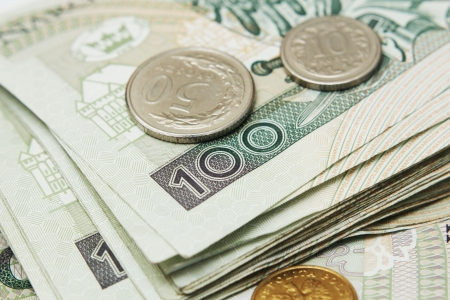 subornation: Poland currency money polish zloty banknotes and coins. Close-up  Stock Photo