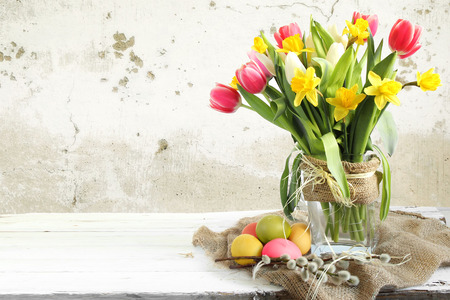 Vase of Tulips and easter eggs photo