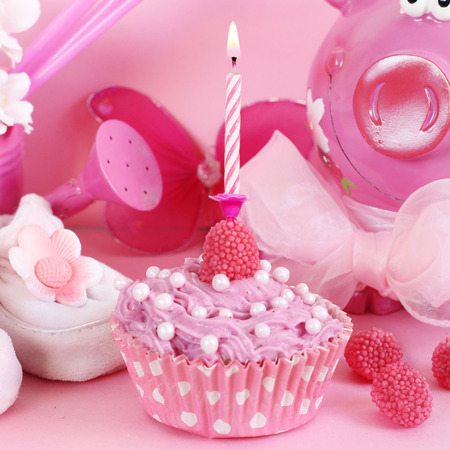 cake pick: Cupcake and baby decoration in pink color Stock Photo