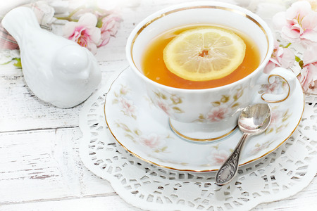 tea in elegant cup in retro style  photo