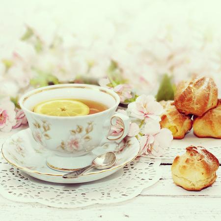 snack time: tea in elegant cup in retro style  Stock Photo
