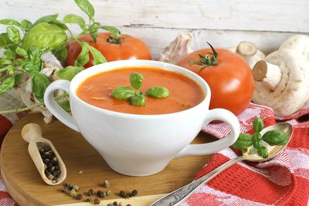 tomato soup: Traditional tomato soup with basil Stock Photo