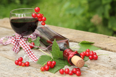 red currant: Red currant wine in glass on natural background Stock Photo