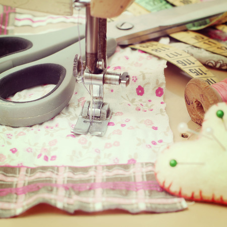 sewing machine, dressmaker scissors and thread-style retro photo