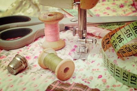 sewing machine, dressmaker scissors and thread-style retro photo