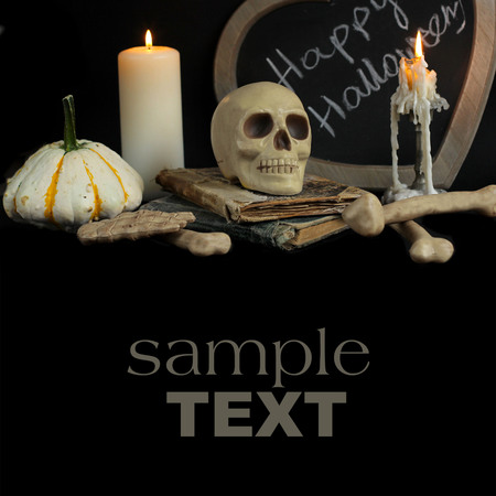 spell: burning candle and  skull. halloween image Stock Photo