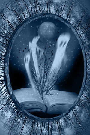 hollow tree: book with Halloween stories Stock Photo