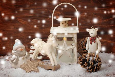 rocking horse,teddy bear and lantern on christmas background photo