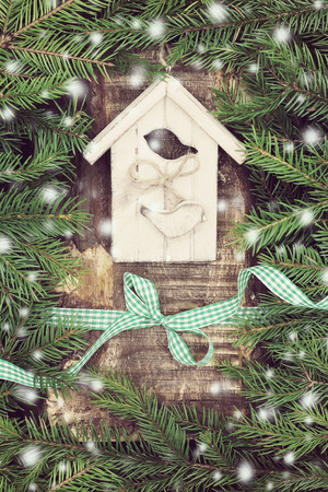Christmas composition with small bird house. photo