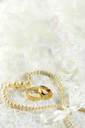 rose ring: Two golden wedding rings with seamless flower decorations Stock Photo