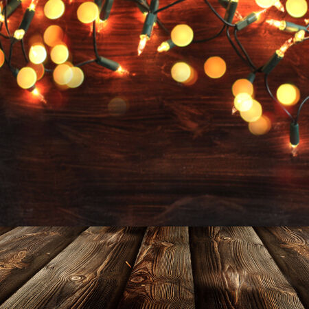 holiday lights display: Christmas  background with empty rustic table