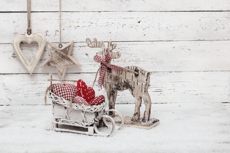 Christmas Reindeer on wooden background in scandinavian style photo