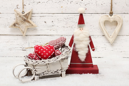 scandinavian christmas: Santa Claus and christmas decoration on wooden background in scandinavian style