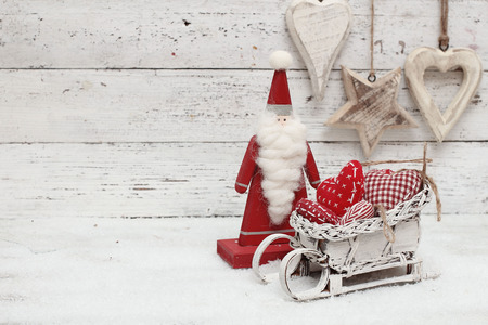 Santa Claus and christmas decoration on wooden background in scandinavian style