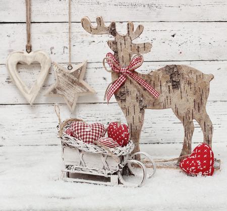 scandinavian christmas: Christmas Reindeer on wooden background in scandinavian style