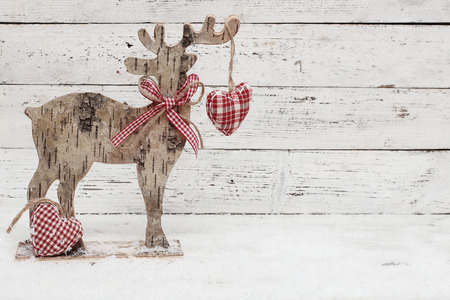 Christmas Reindeer on wooden background in scandinavian style