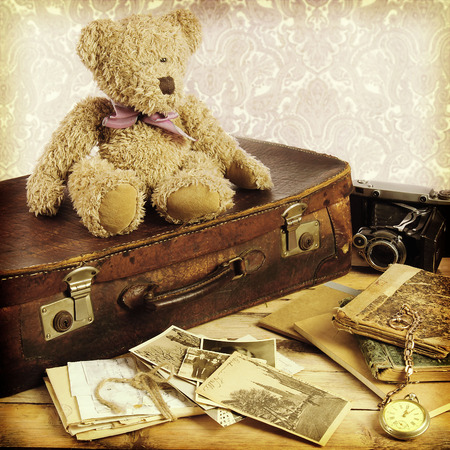 old suitcase: old suitcase, books, photos in retro style