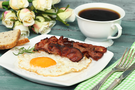 bacon and eggs: Fried eggs with bacon on the wooden table