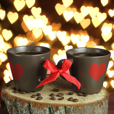 two cups of coffee with ribbons. Valentine card. photo