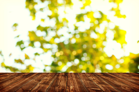 summer background: Wooden deck table with spring bokeh background
