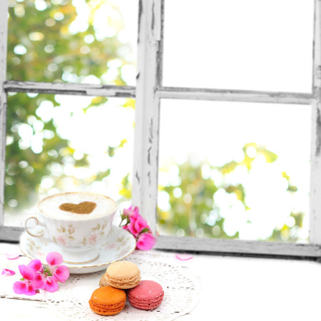 Macaroons traditional Parisian cookie with cup of coffee photo