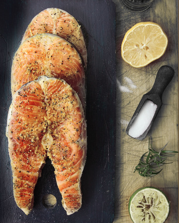 Raw salmon fish steaks with spices photo