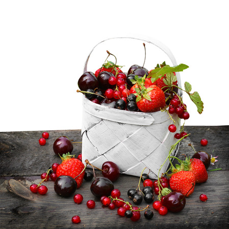 strawberry baskets: Mix of fresh berries in a basket Stock Photo