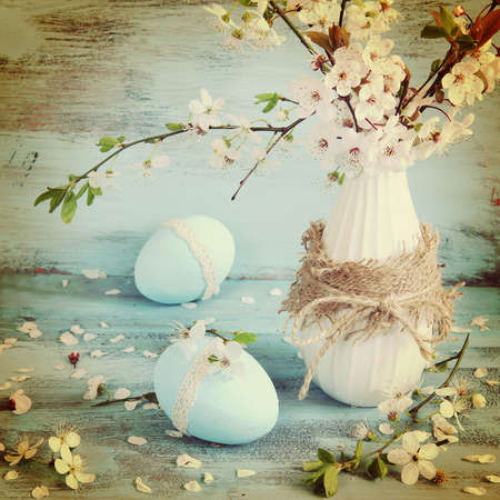 easter tree: easter eggs and blossom apple tree in vase Stock Photo