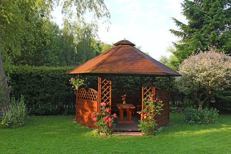 summerhouse: Wooden summerhouse in the garden