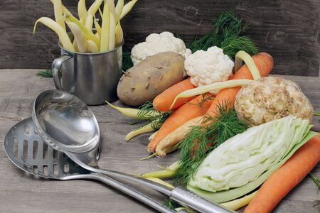 raw vegetables for soup on wooden table photo