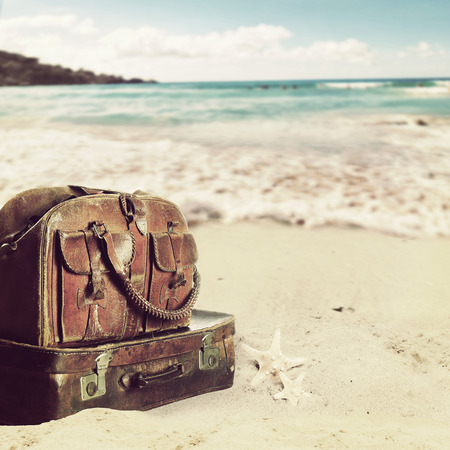 baggage on a beach. Concept for travel agents Stock Photo