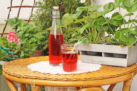 soda water: drink in a glass on a table in the garden