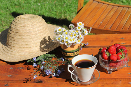 table and chairs: coffee in the garden in summer time Stock Photo