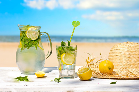 Lemon drink  and beach in the background