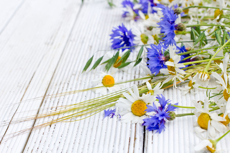 rye: Summer wildflowers and rye on wooden background