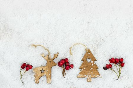 christmas tree decoration: christmas background with wooden reindeer