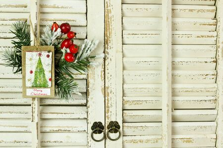 campanas: Christmas decoration hanging over rustic wooden background Foto de archivo