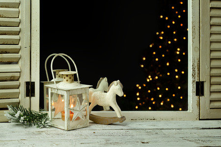 antik: wooden rocking horse and lantern on a wooden rustic background Stock Photo